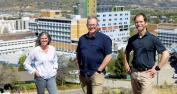 Emergency Preparedness and Response project team (Rhonda Eden, project lead, Dr Graham Dodd, family physician lead, and Colin Swan, Interior Health emergency management coordinator) in Sahali Terrace Nature Park overlooking Royal Inland Hospital in Kamloops